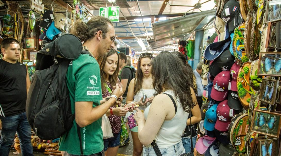 A volunteers talks to the locals at a market as part of his Spanish course in Costa Rica